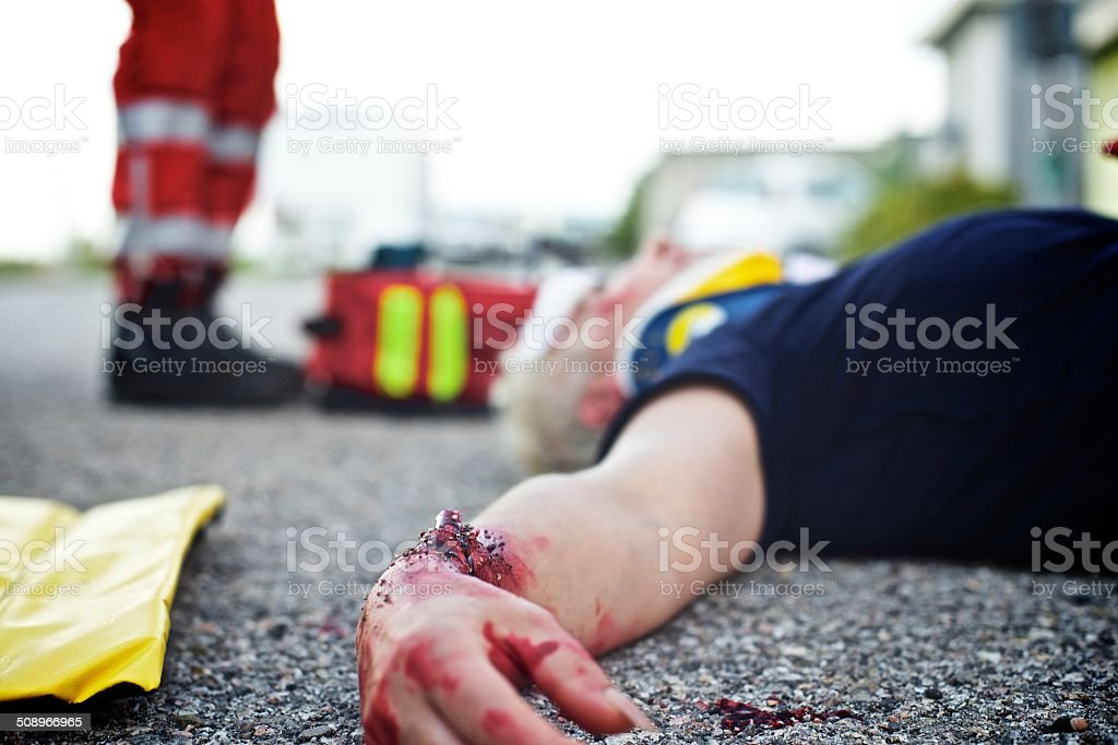 Wounded woman with paramedic stock photo