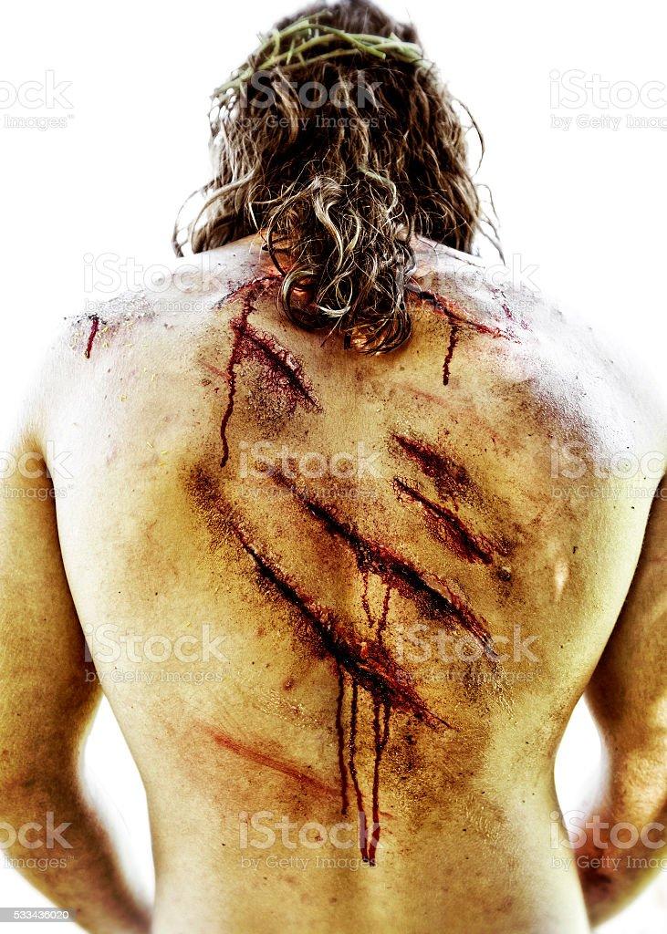 Wounds on Jesus Christe back. stock photo