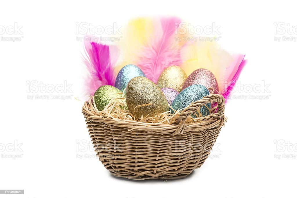 Woven basket full of colorful easter eggs with feathers (XXXLarge) royalty-free stock photo