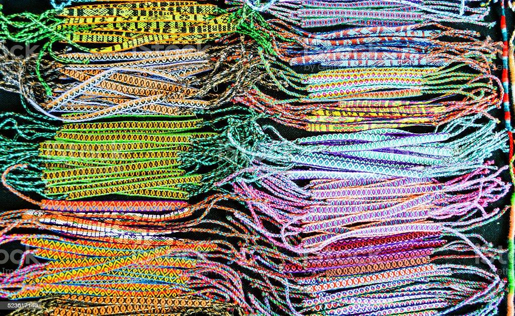 Woven bracelets at marketplace stock photo