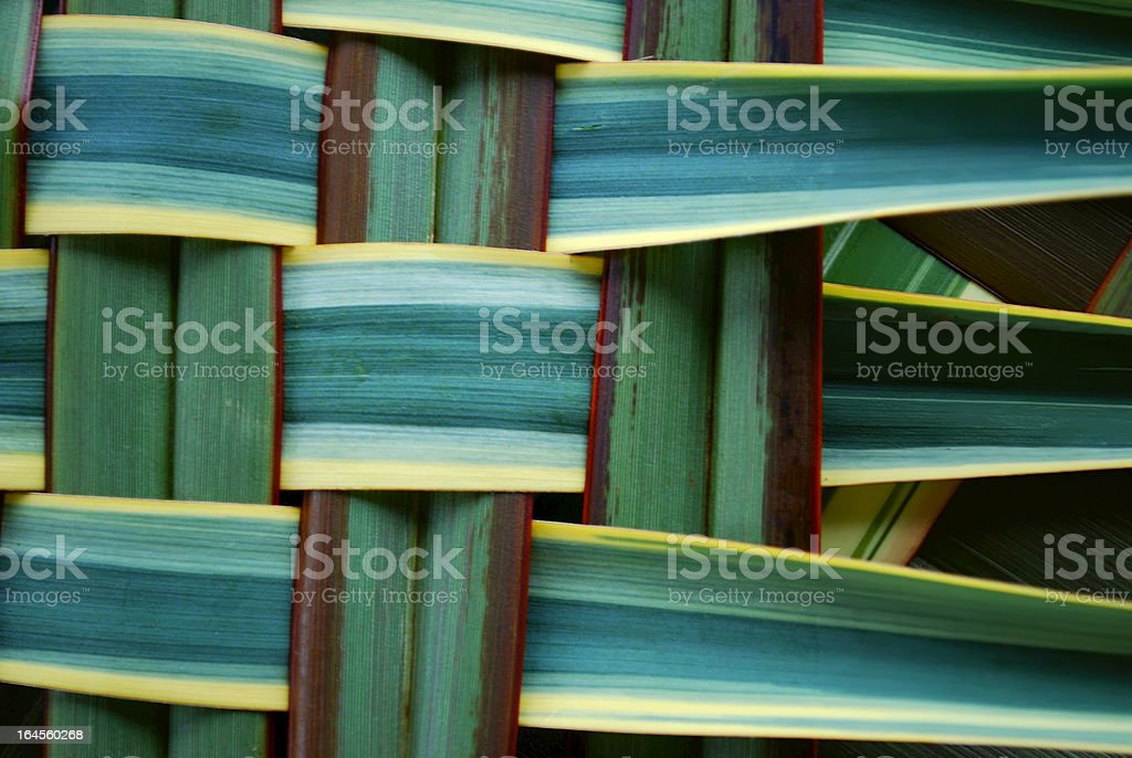 Woven green, brown and yellow grass background stock photo