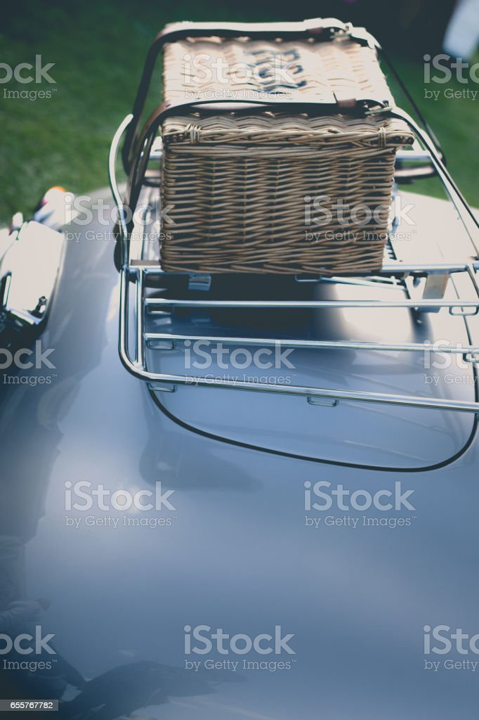 Woven travel basket connected to trunk stock photo