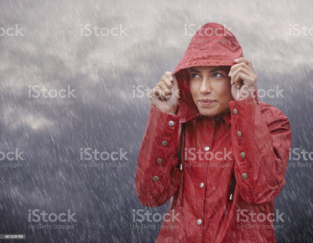 Wow, I'm glad I wore my raincoat! stock photo