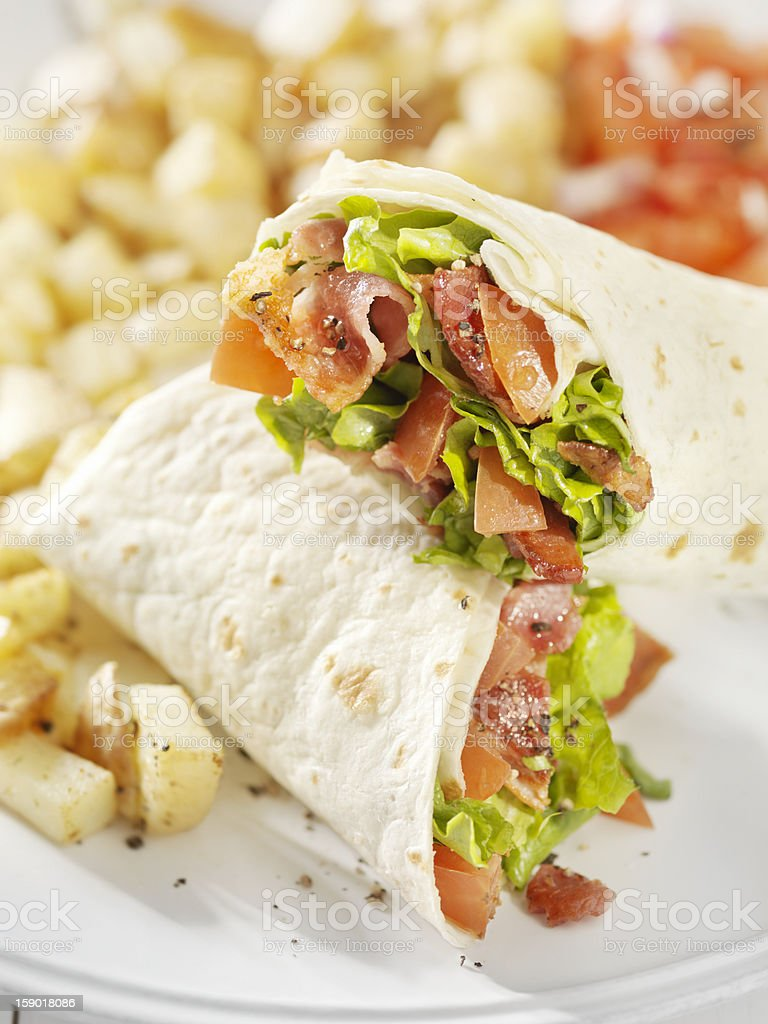 BLT Wrap Sandwich with Hashbrown Potatoes royalty-free stock photo