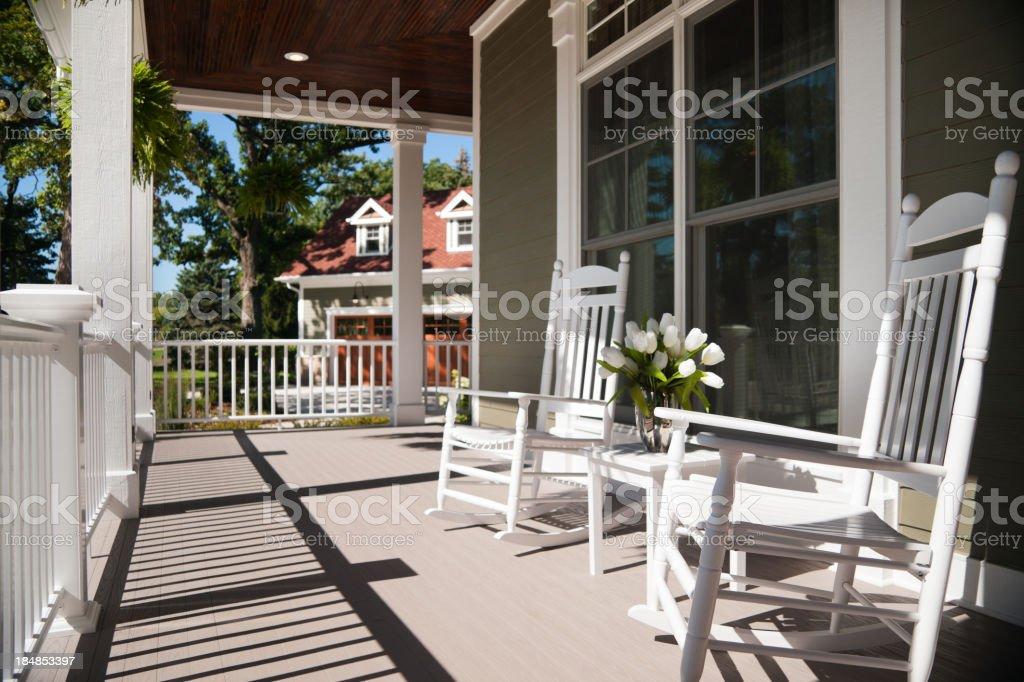 Wrap-around porch in summer. stock photo