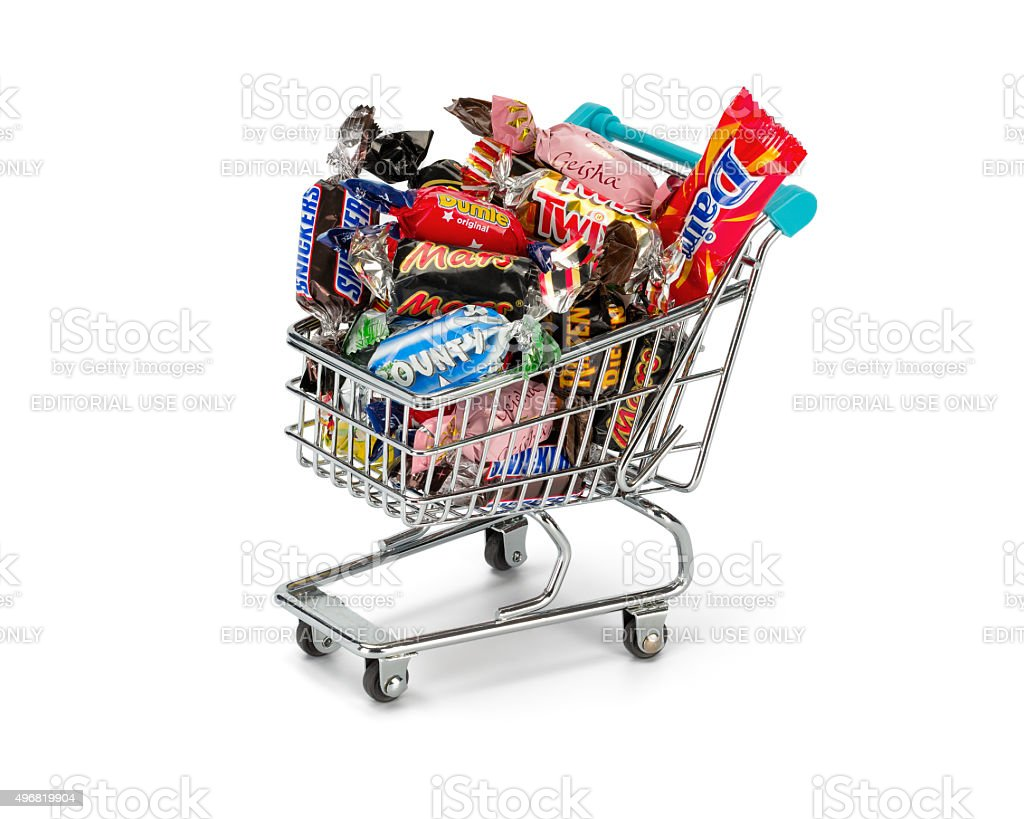Wrapped chocolate bars in a shopping cart. stock photo
