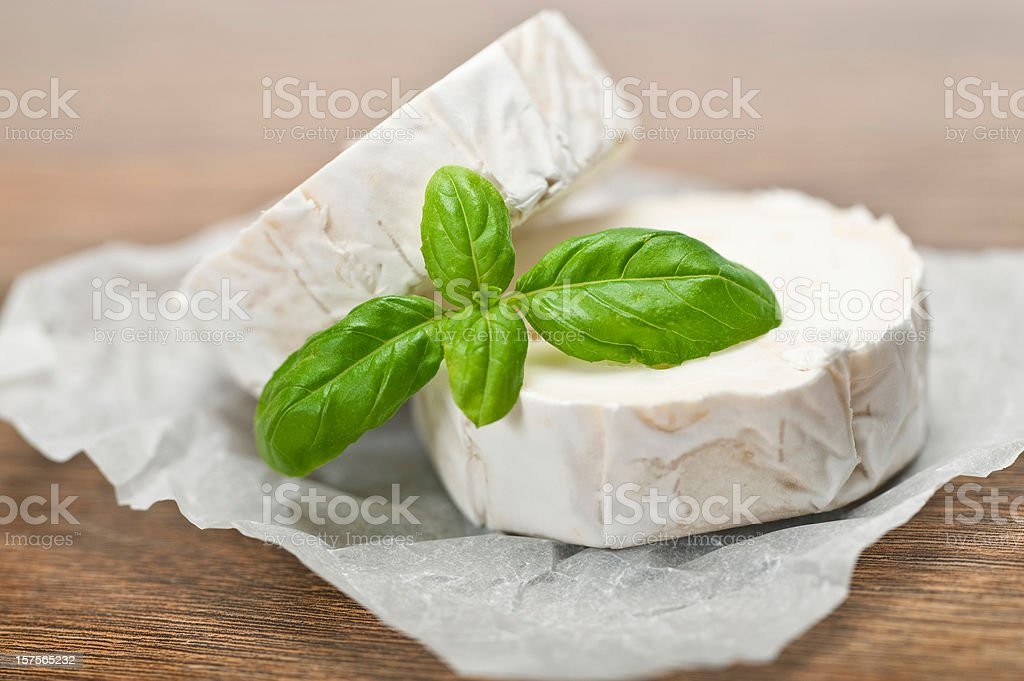 Wrapped circles or goat cheese displayed with garnish stock photo