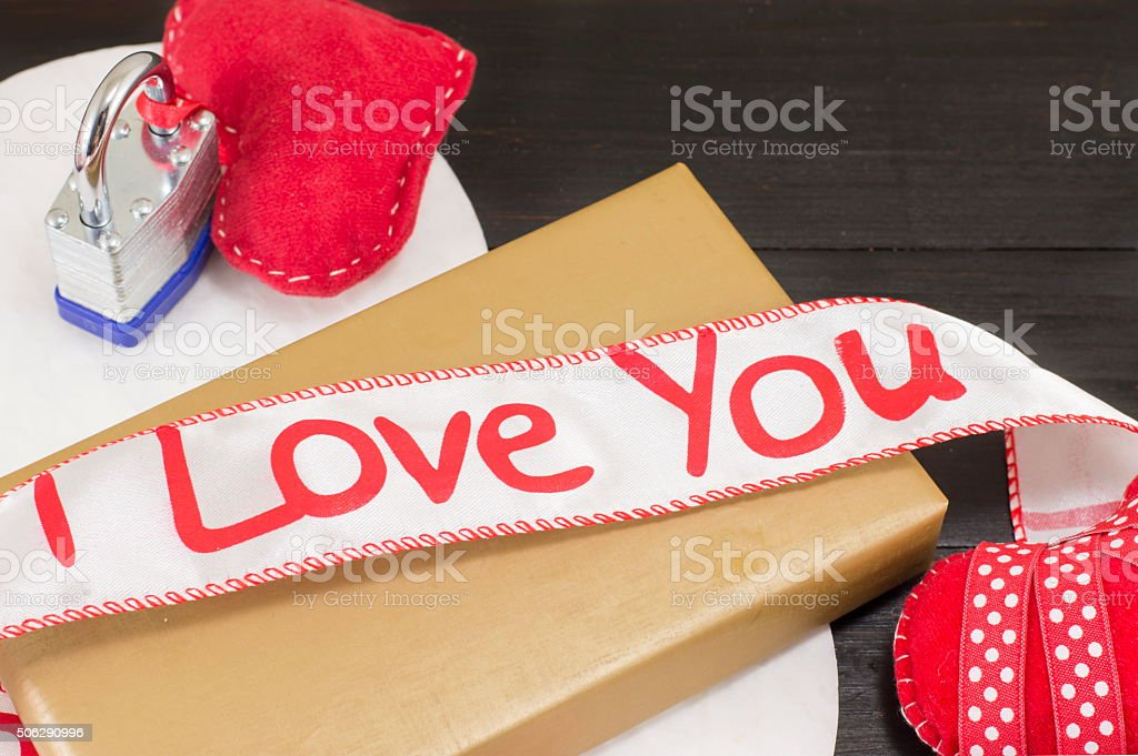wrapped gift and 'I love you' ribbon stock photo