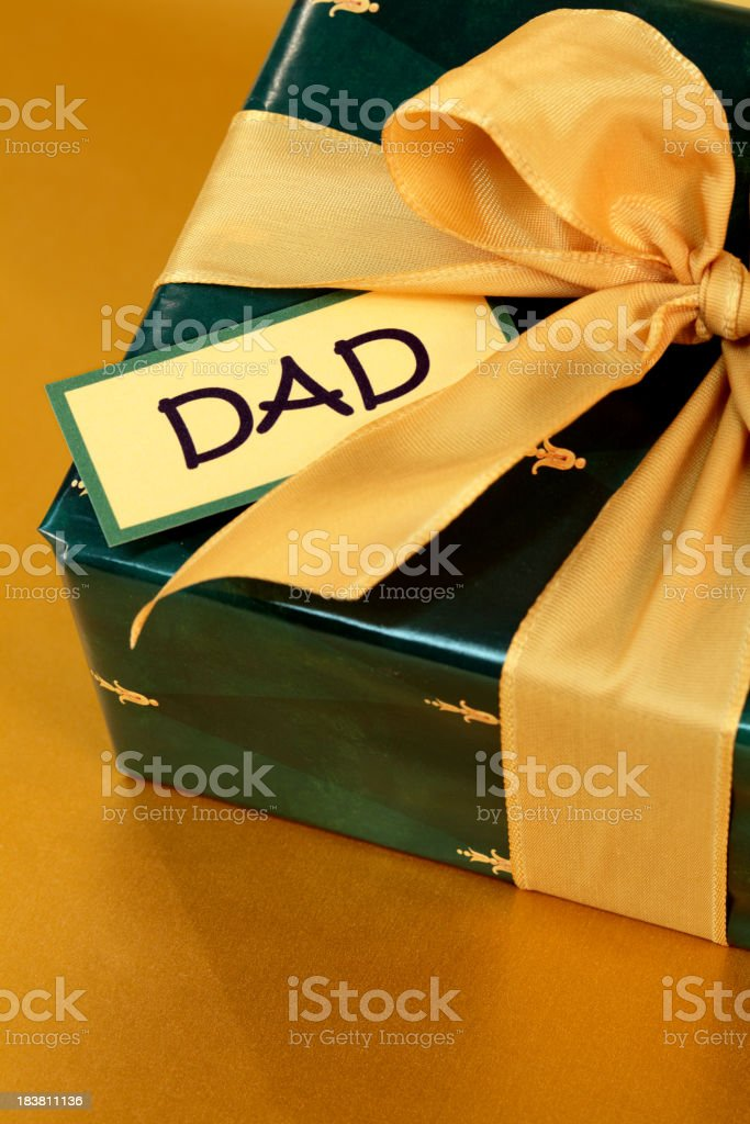 Wrapped Gift for Dad with Gold Bow stock photo