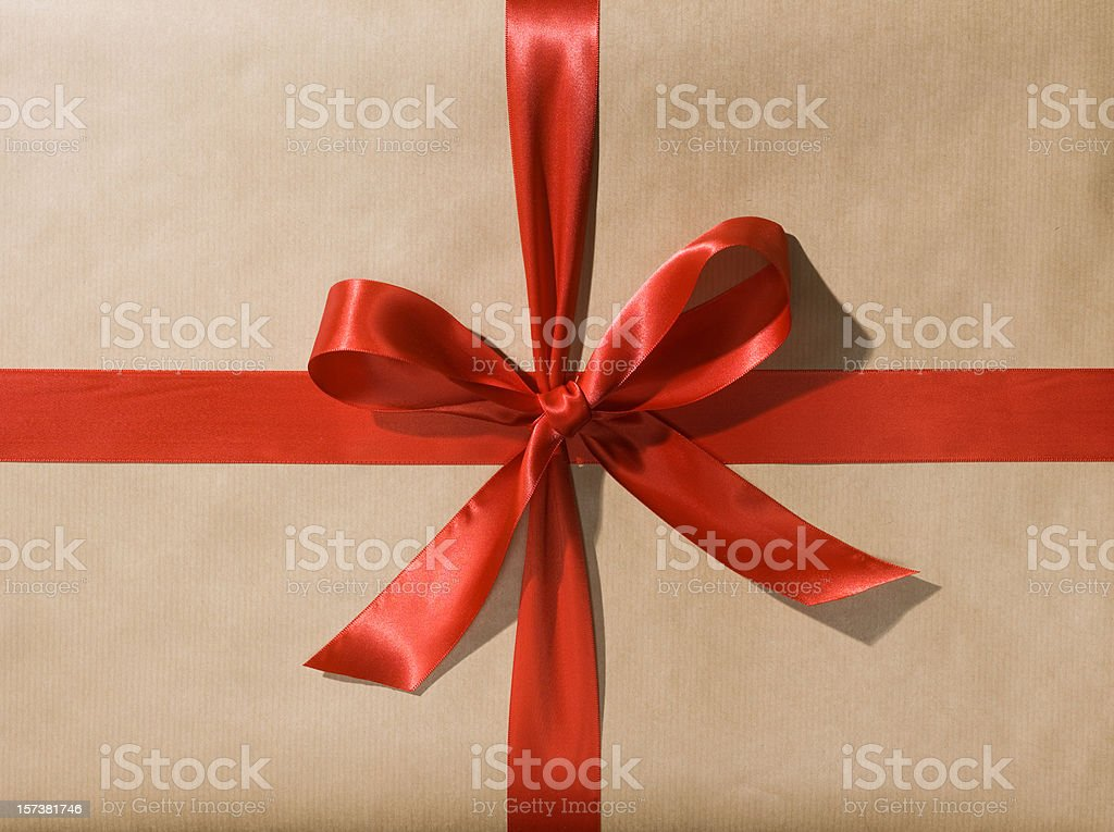 Wrapped Gift or Present with Red Ribbon Bow stock photo