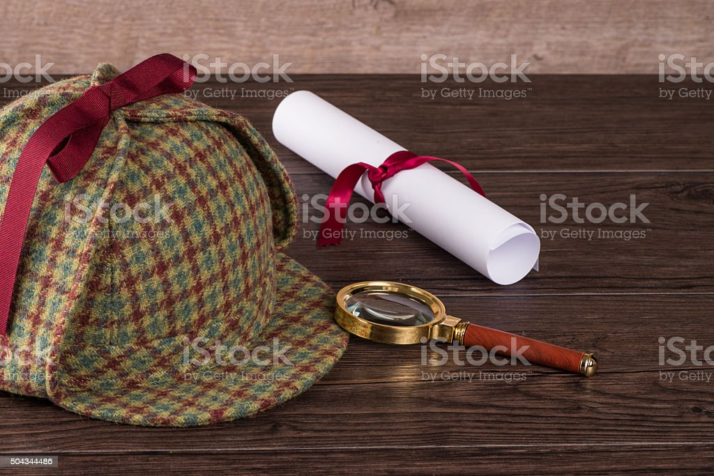 Wrapped paper sheets and magnifying glass stock photo