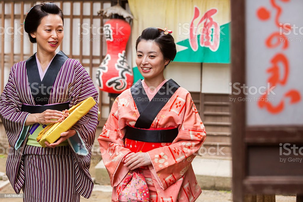 Wrapped Parcels With Traditional Japanese Women in Kimonos stock photo