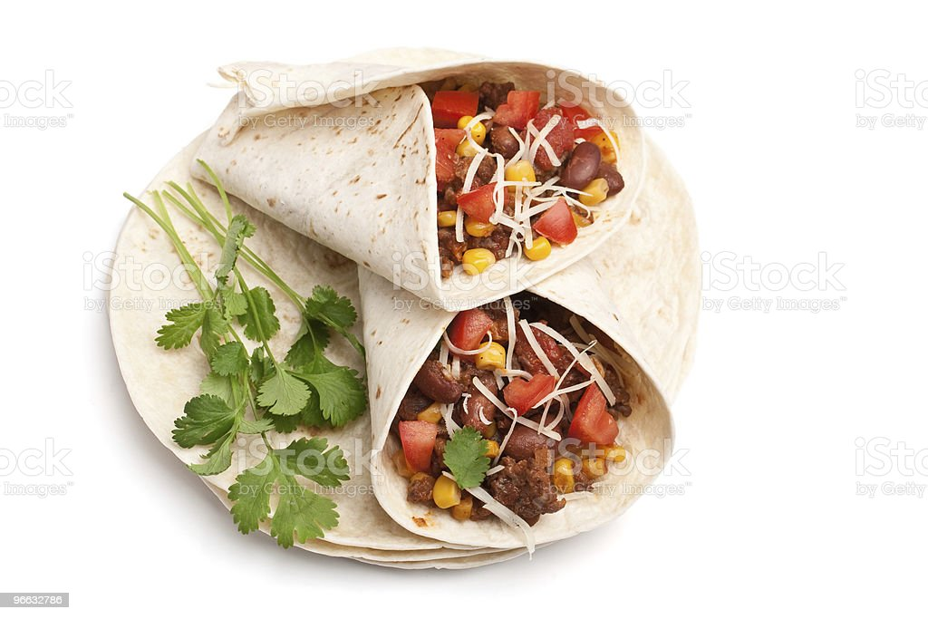 wrapped tortilla stuffed with beef chili and cilantro royalty-free stock photo