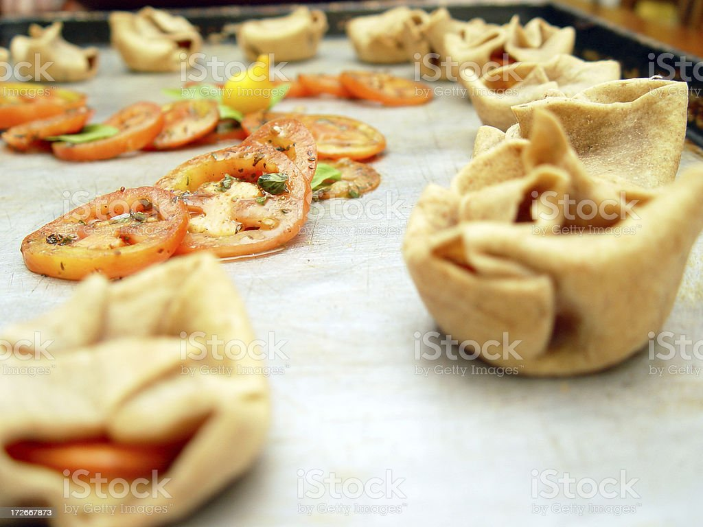 Wrapped Treats and Tomatoes stock photo