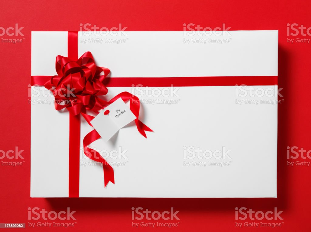 Wrapped Valentine Gift with Red Bow stock photo