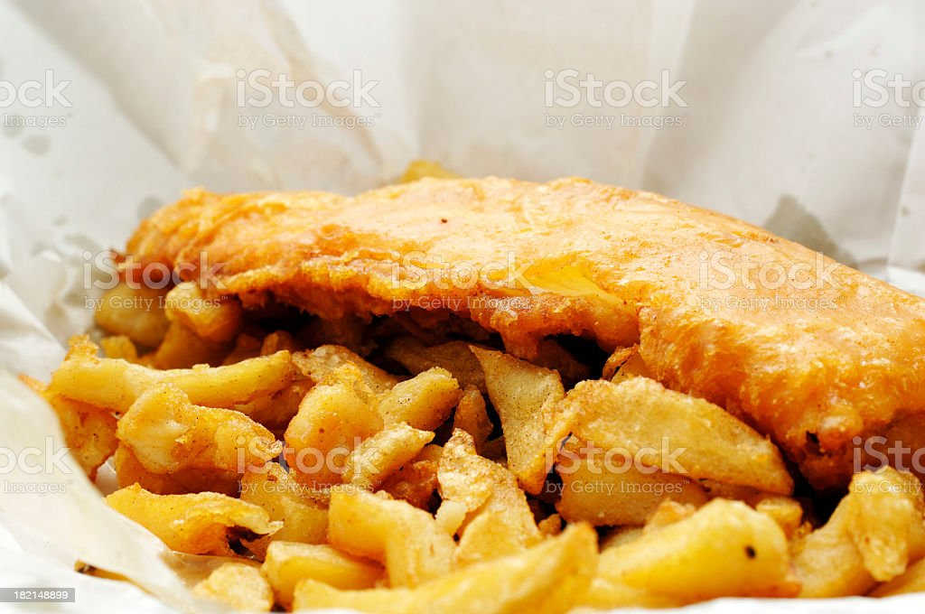 wrapper of english fish and chips stock photo