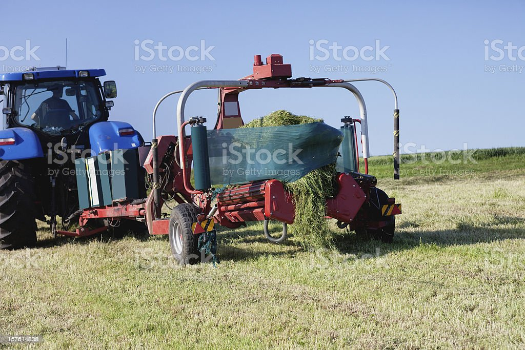 Wrapping a Hay Bale stock photo