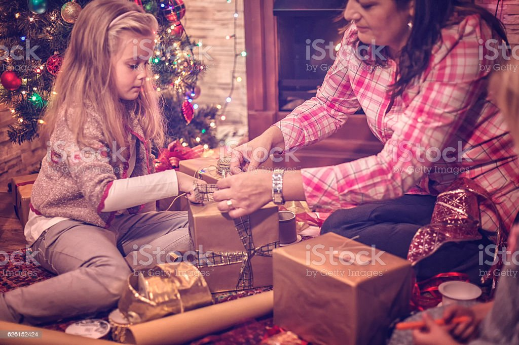 Wrapping and Decorating Christmas Presents stock photo