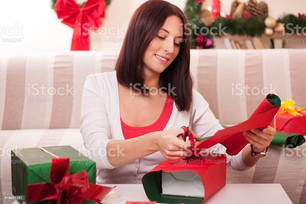 Wrapping Christmas gift. stock photo