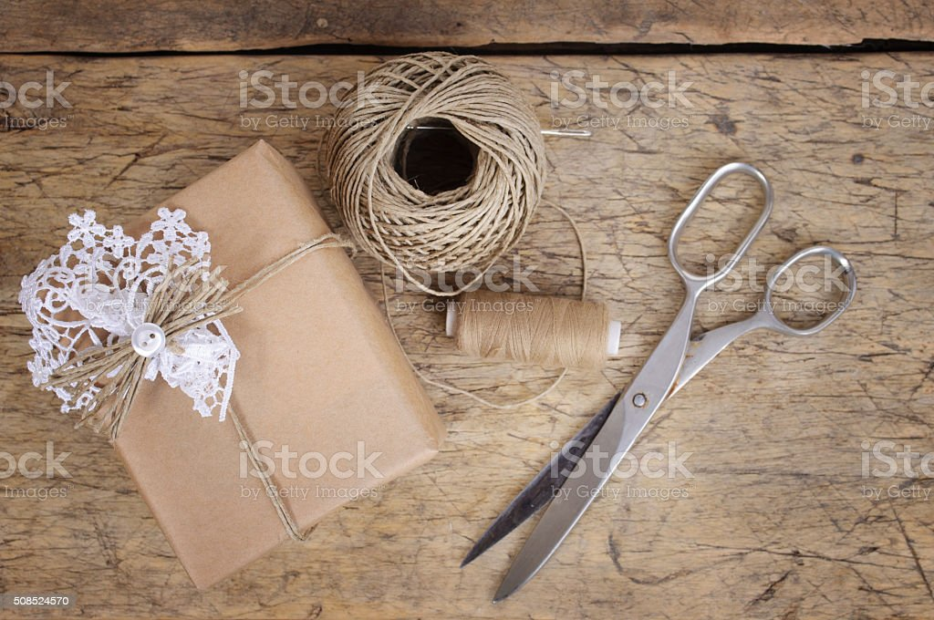 Wrapping eco gift packages with brown paper and string stock photo