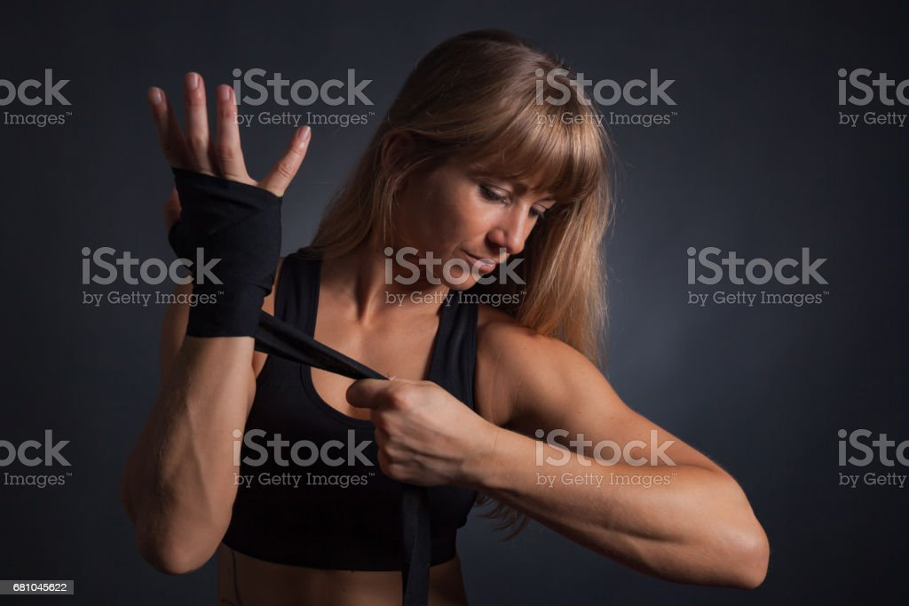 wrapping hands with boxing wraps stock photo