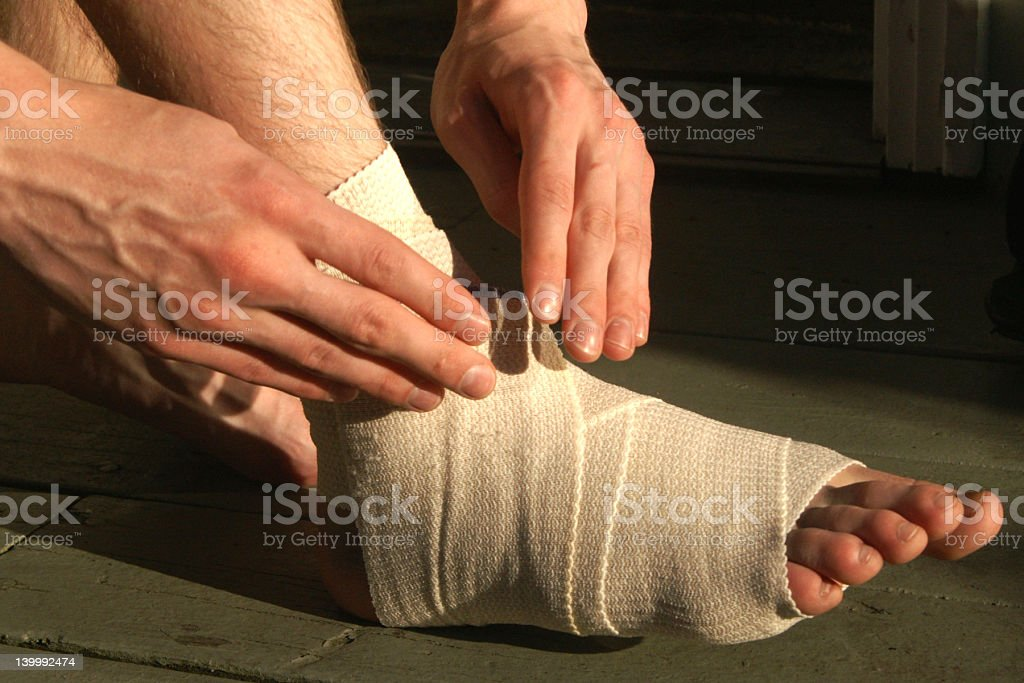 wrapping the foot royalty-free stock photo