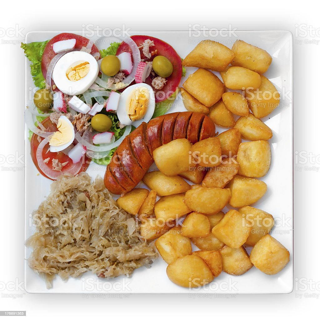 wratwurst with sauerkraut salad and potatoes royalty-free stock photo