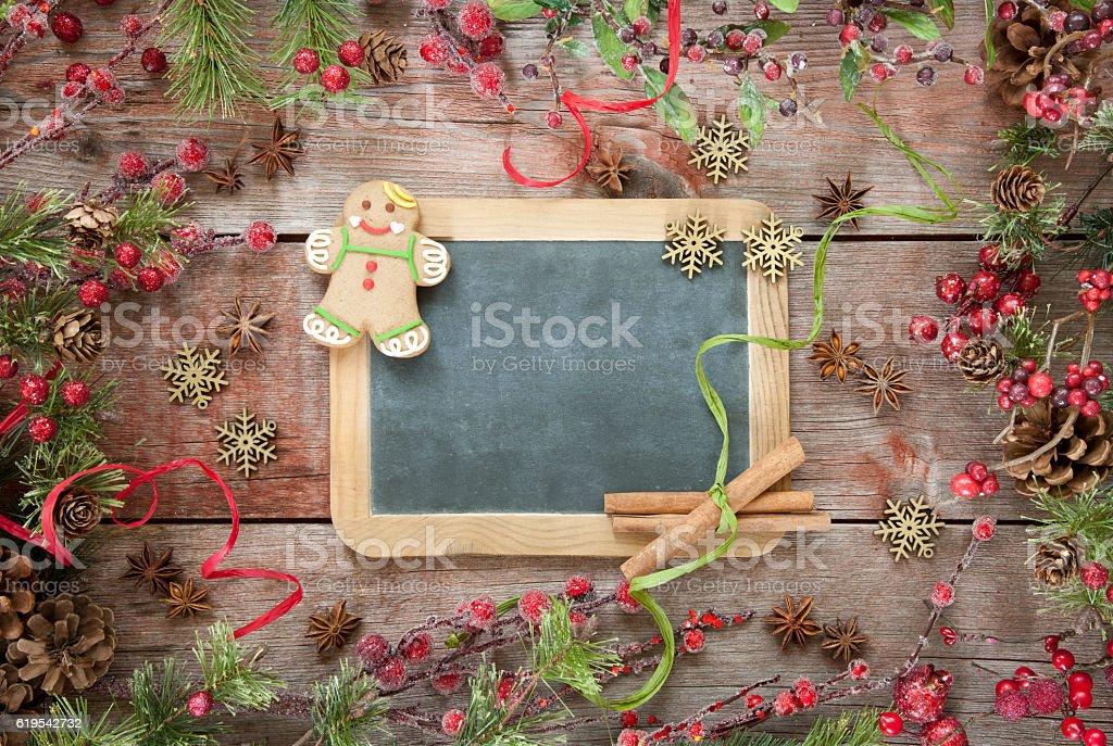 Wreath Garland Pine Border on a Rustic Wood Blackboard Background stock photo