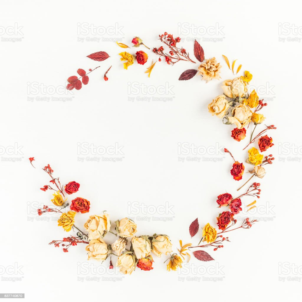 Wreath made of autumn leaves, flowers. Flat lay, top view stock photo