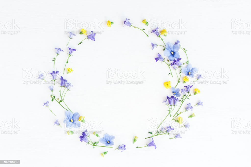 Wreath made of bell flowers, pansy flowers and yellow flowers stock photo