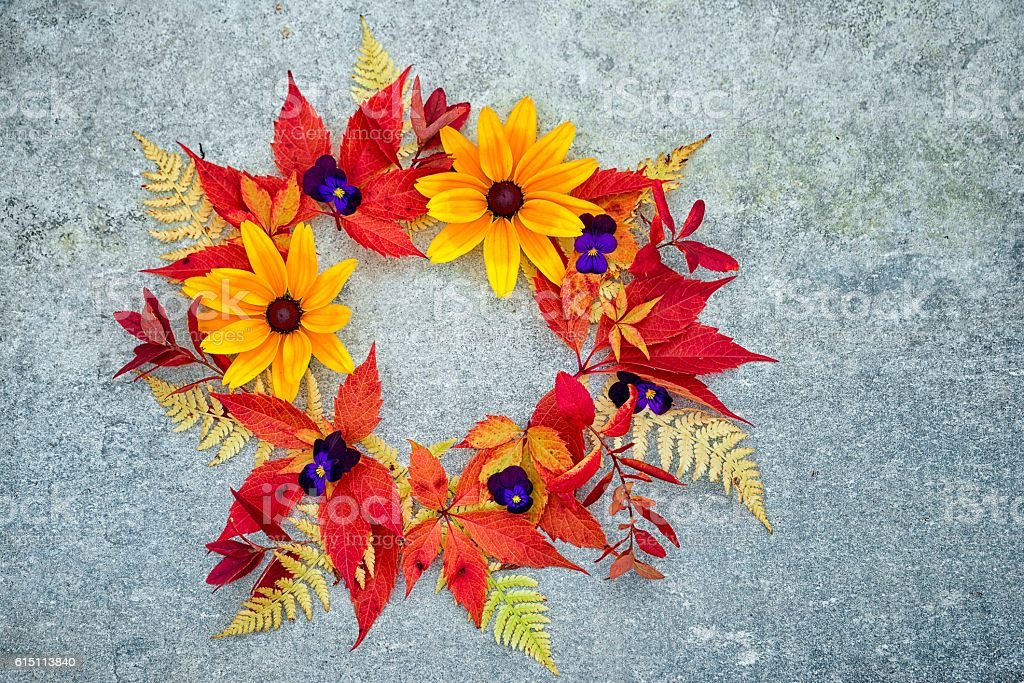 wreath of autumn leaves and flowers stock photo