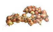 Wreath of onions on a light background