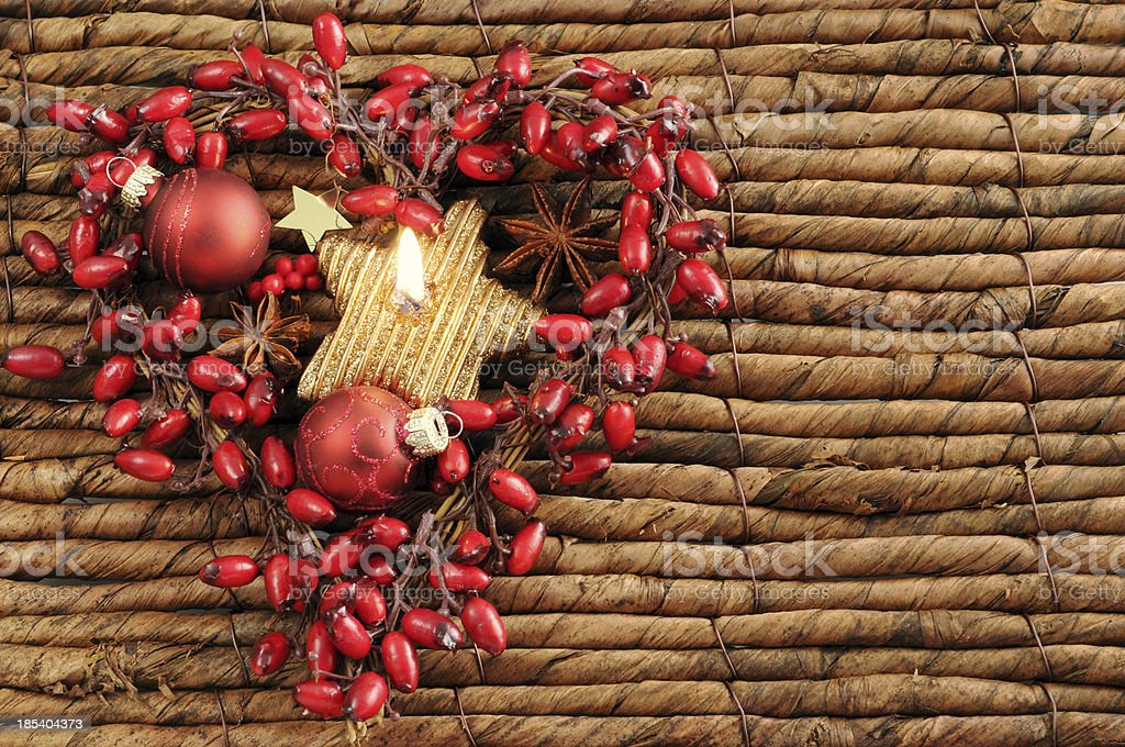 wreath of rose hip with tealight and copyspace stock photo