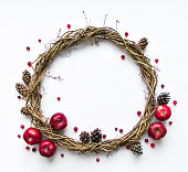 Wreath of vines decorated with apples and berries. Flat lay