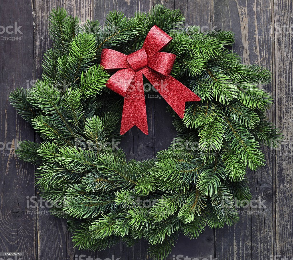 Wreath on old wooden background royalty-free stock photo