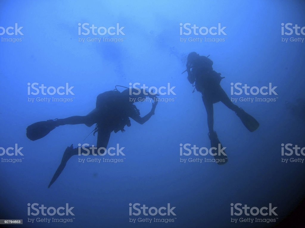 Wreck dive scuba divers blue water royalty-free stock photo
