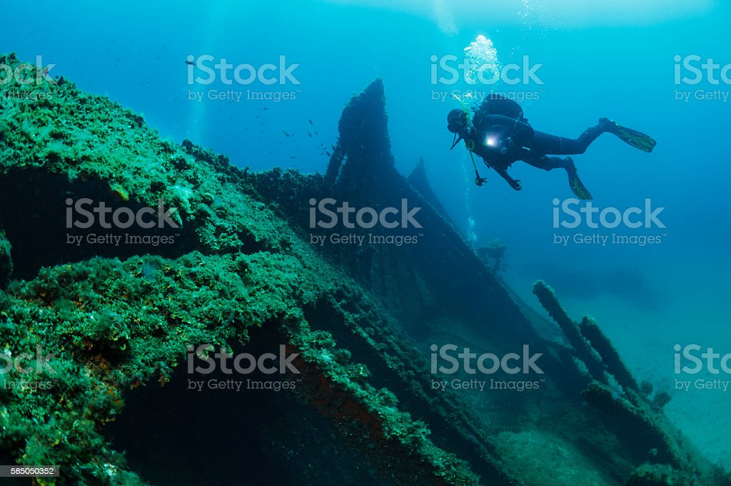 Wreck diving over a shipwreck Scuba diver point of view stock photo