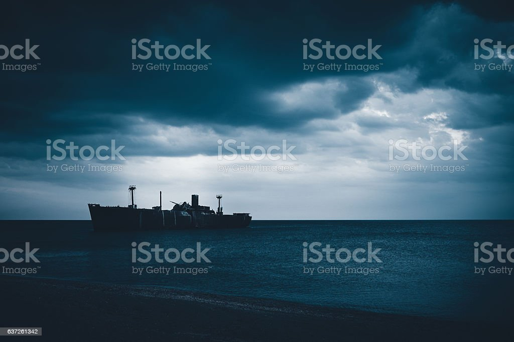 wreck in the middle of the sea stock photo