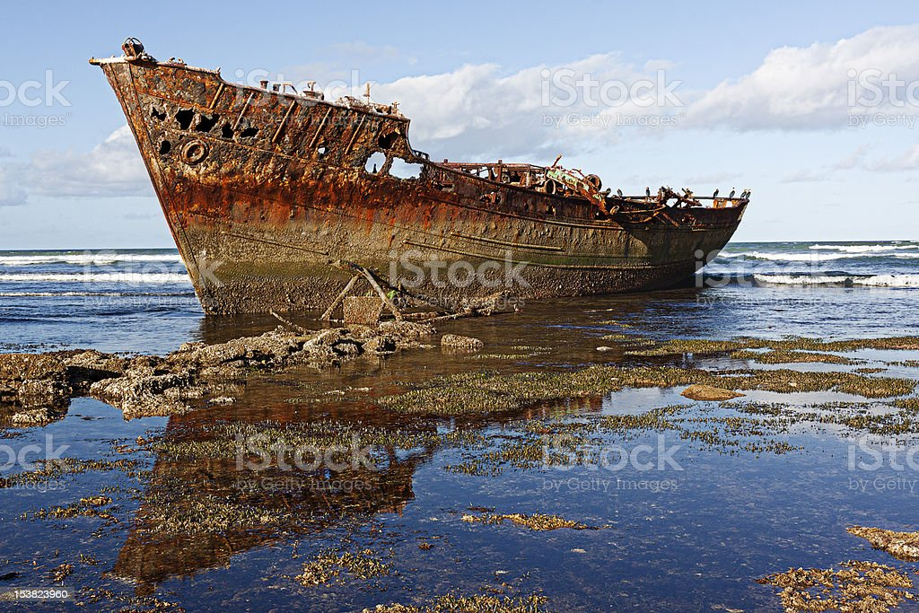 Wreck of a ship on African coast royalty-free stock photo