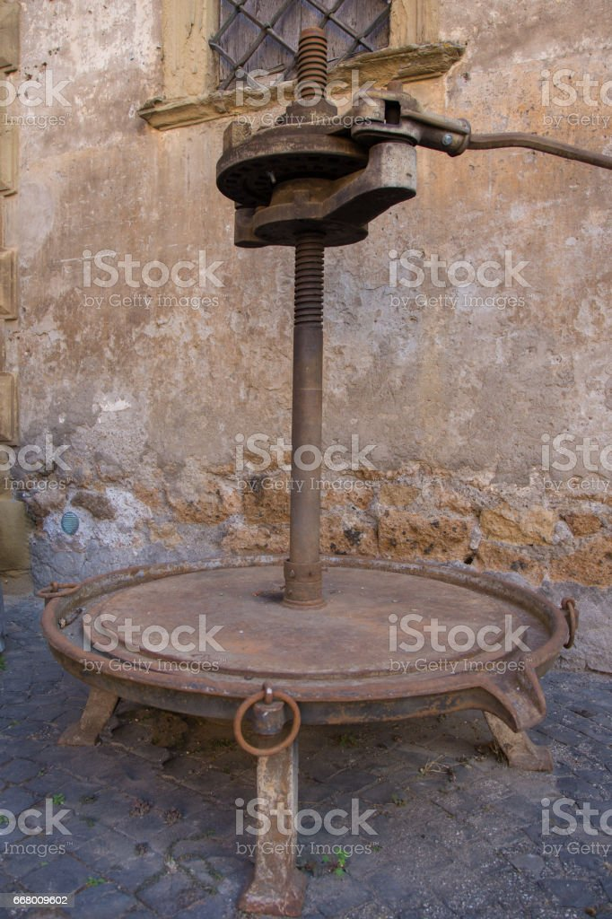 Wreck of an old press for pressing the grapes and get the wine. stock photo