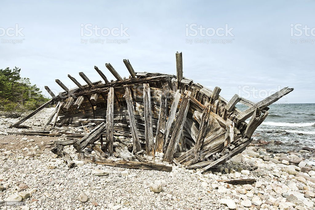 Wreck of an old wooden ship stock photo