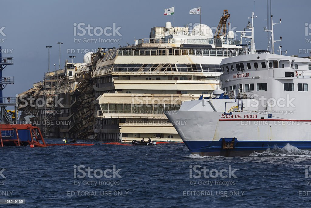 Wreck Of Costa Concordia And Ferry stock photo