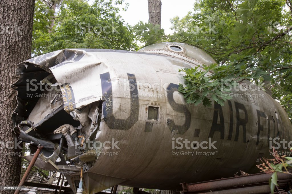 Wreckage of Air Force fighter jet in trees stock photo