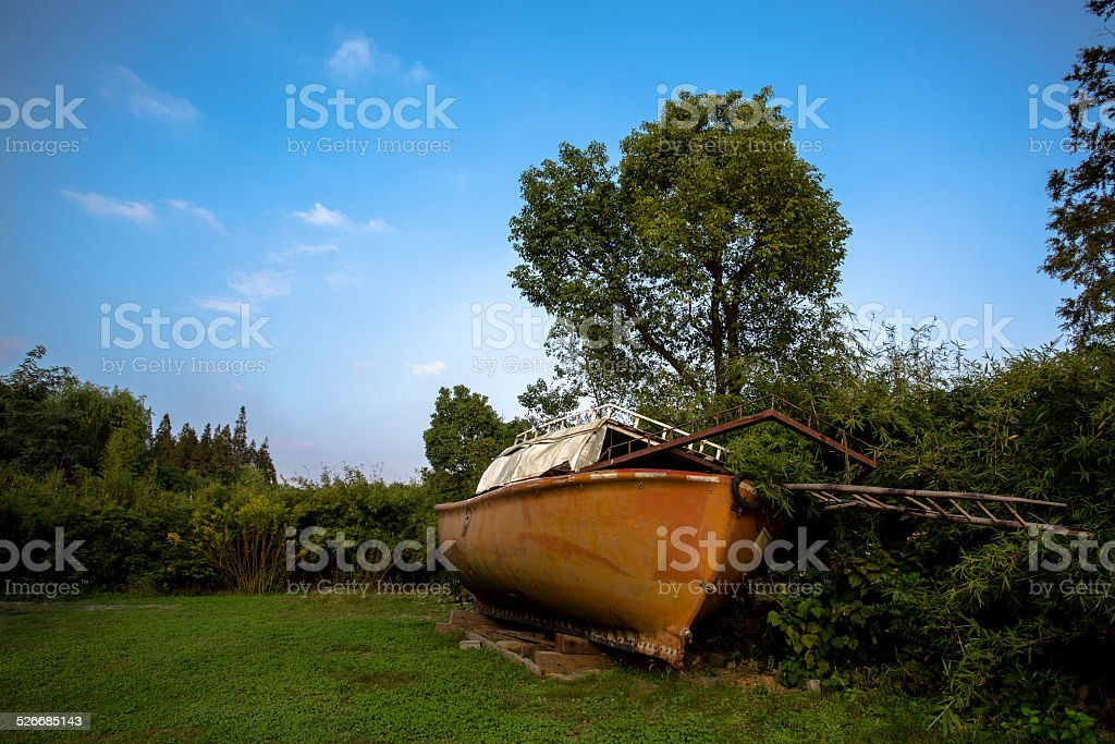 wrecked boat deserted on grassland stock photo