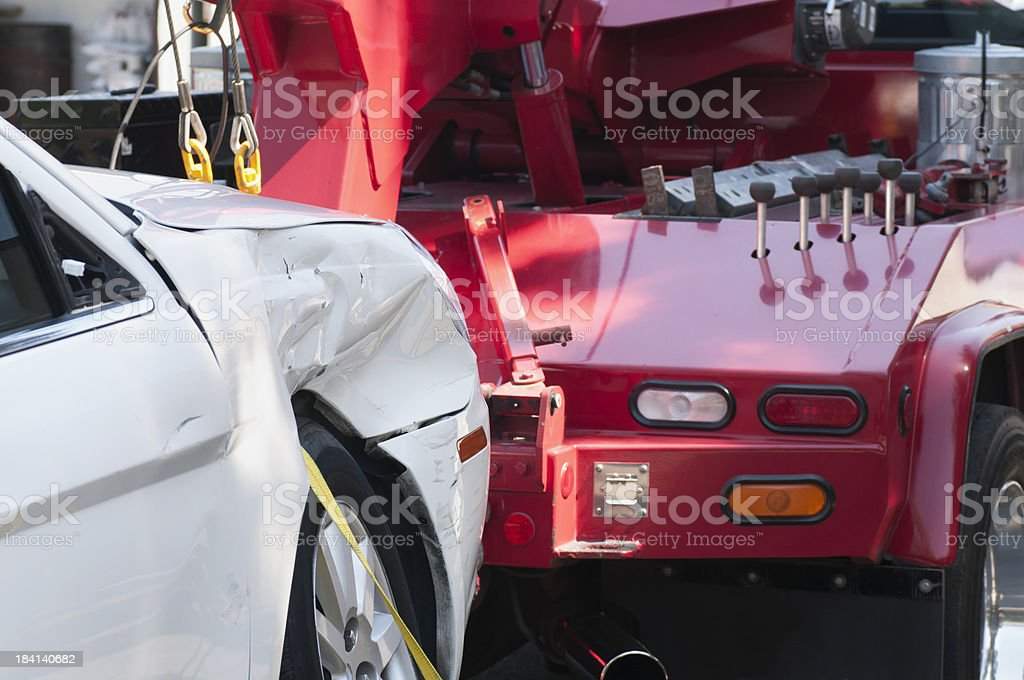 Wrecked Car on a Tow Truck stock photo