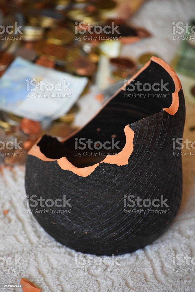 Wrecked moneybox stock photo