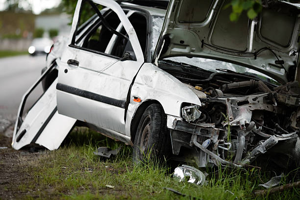wrecked silver car after accident stock photo