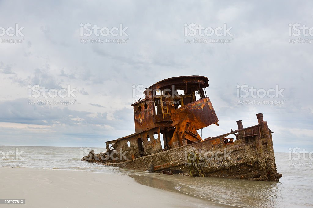 Wrecked Tug Boat stock photo