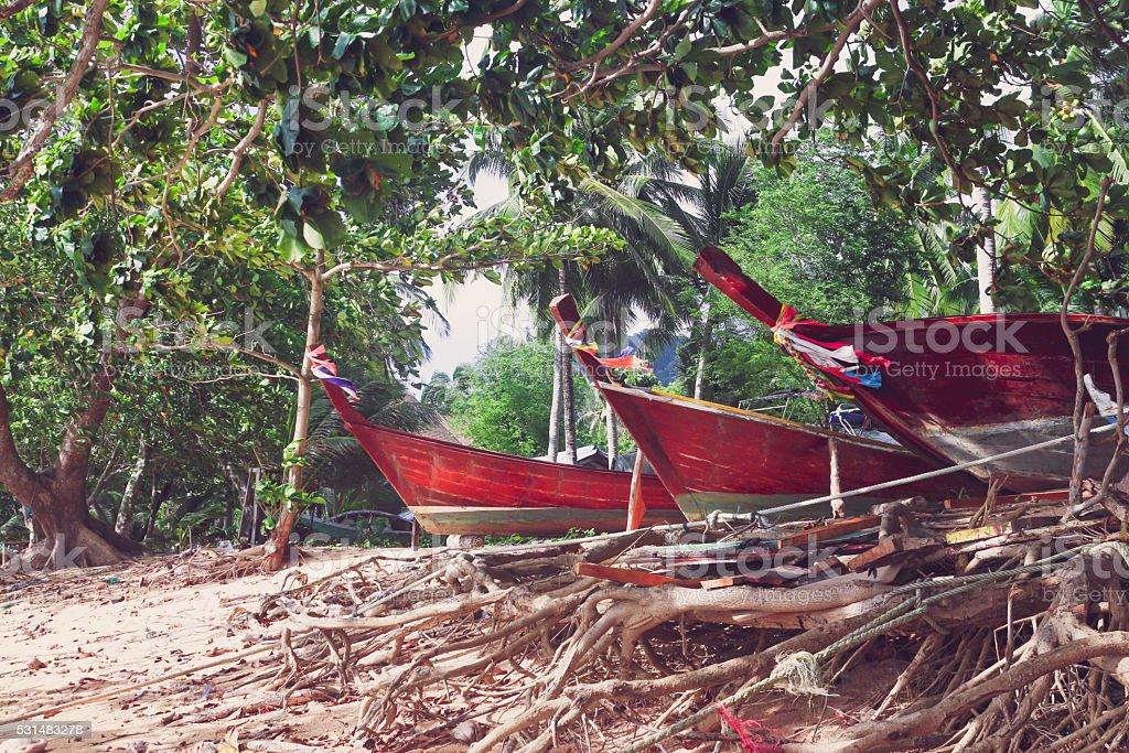 Потрепанный деревянные Длинный хвост лодке Стоковые фото Стоковая фотография