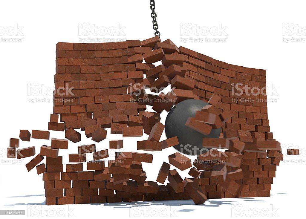 Wrecking ball crashing through brick wall royalty-free stock photo